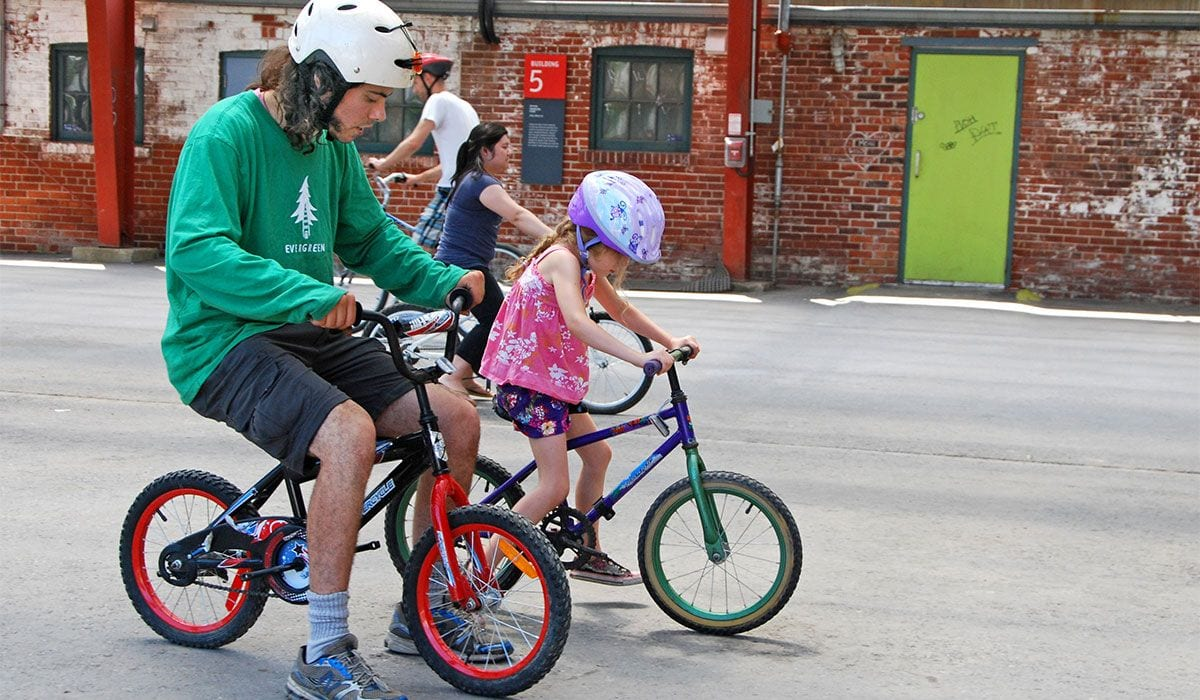 Child being taught to ride a bike
