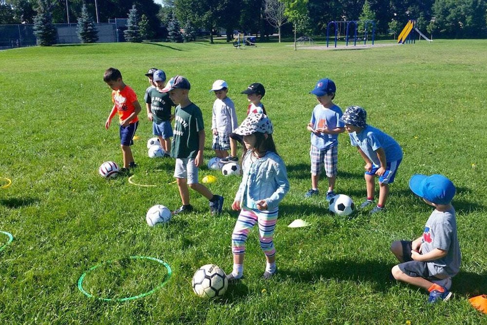 Kids playing soccer at True North Sports Camps