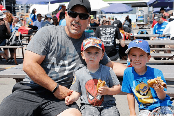 Father with sons at the Honda Indy