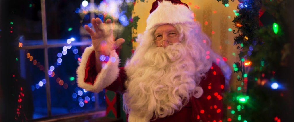 Santa Claus waving at camera