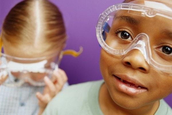 children wearing safety goggles