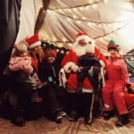 family with Santa in a traditional kota tent