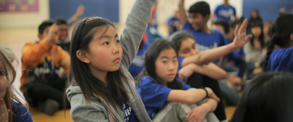 girl raising hand at a Future Possibilities for Kids event