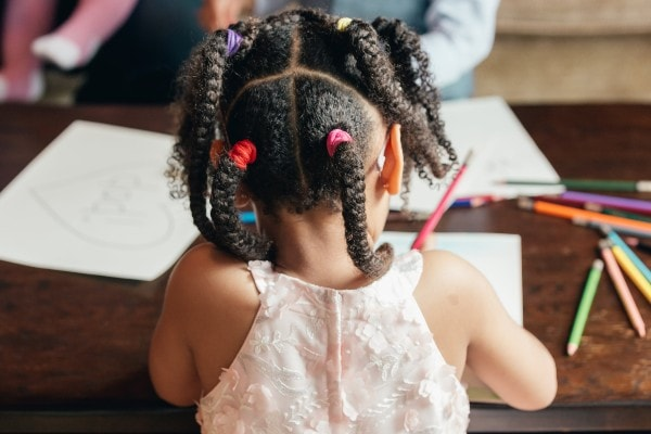 girl drawing viewed from behind